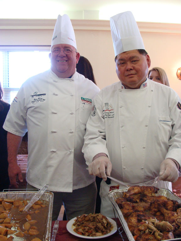 CHEFS Chris Neary, left, and Michael Ty of the American Culinary Federation served some delicious fare to the attendees.