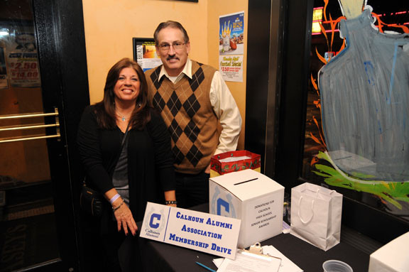 Calhoun High School Alumni Association Co-President Phyllis Bonanno Guttilla, left, and Recording Secretary Rich Stoecker collected donations for the senior scholarship awards.