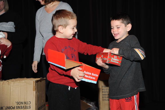 Cousins Christopher and Justin Verdi, both age 5, helped to hand out gifts.