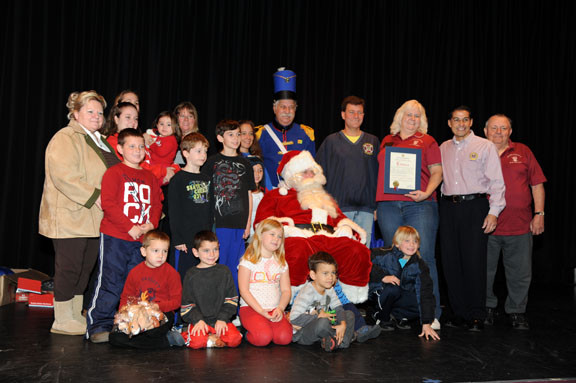 Nassau County Legislator Dave Denenberg, fourth from right, top, and Town of Hempstead Clerk Mark Bonilla, second from right, joined chamber members and children during the festivities.