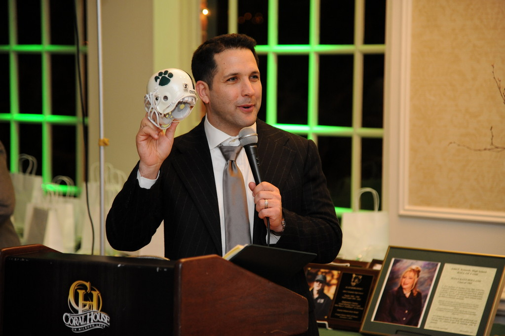 Adam Schefter, National Football League sports analyst, was presented with a mini cougar helmet to be placed on his bookcase during ESPN broadcasts.