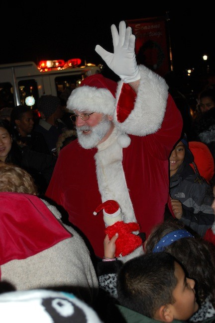 Santa greeted a large crowd after arriving in a Valley Stream fire truck.