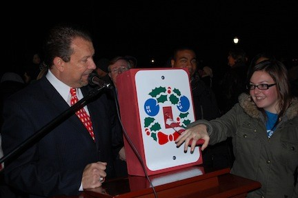 Mayor Ed Fare got some help from Mayor for a Day essay contest winner ToniRaquel Spota to light the Christmas tree.