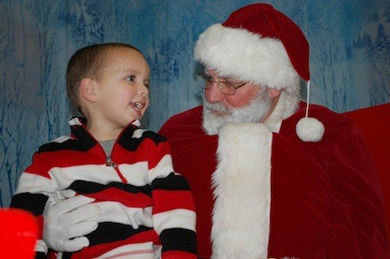 Joaquin Pagan, 3, was one of hundreds of children who got to meet Jolly Old St. Nick at Village Hall last Friday night.