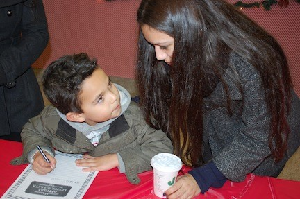 Brandon Bermudez, 6, joined by his sister Stephannie, pondered his wish list for Santa.
