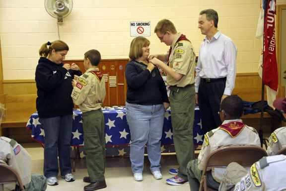 Eagle Scout hopefuls Frank Rossetti and Thomas Ferrall pinned badge on their mothers at the troop's Court of Honor ceremony on Nov. 20.