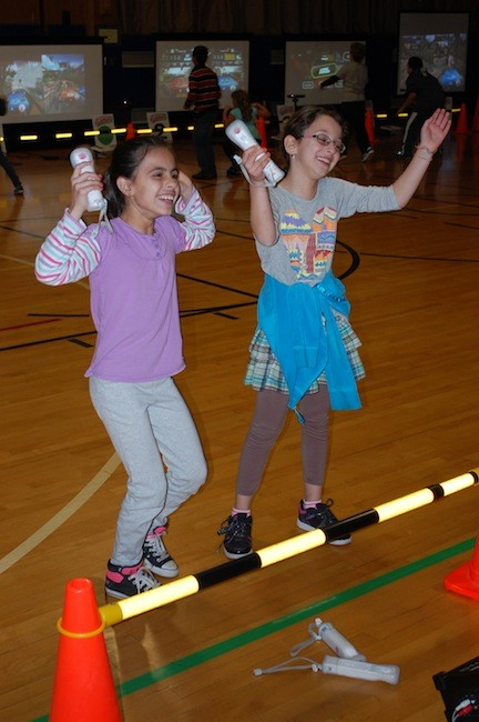 Fourth-graders Miriam Yeni and Victoria Melo loved the dancing games.