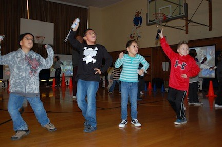 Students at the William L. Buck School played interactive video games in phys. ed. classes last week, a program brought to District 24 by Suffolk-based company iGame4.