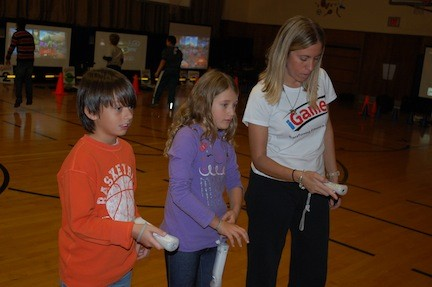 Mark Campbell and Julia Cole, fourth-graders at the Buck School, got some help from Jennifer Reich of iGame4 to set up a video game. The program will be brought to District 24�s other schools this week and next.