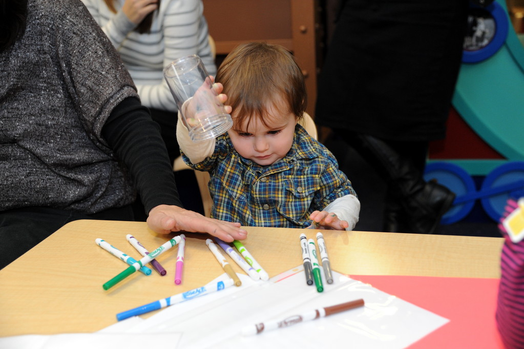 One-year-old Ali showed how quickly she can empty a jar of markers at the Levi Yitzhak Library anniversary party.