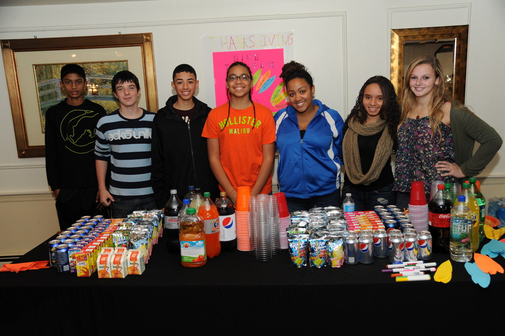 Lawrence High School students served the beverages. From left were, Karan Rapersand, Chase Doyle, Michael Lerebours, Amir Mackey Iveliz Hernandez, Jizzel George and Taylor Muller.