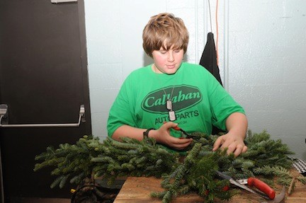 Wreath-maker John Dorney, 12, at the craft fair in the Rec Center.