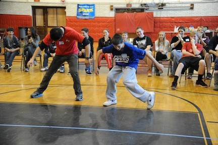 "Challenge day leder ""EV"" and Colin Mooney dancing during South Side MIddle School's Challenge Day."