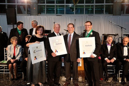 Holding their awards were Nancy Carr, John Coghlan and Dr. Marc DiSciullo, far right, at the 76th annual Mercy Ball. They were joined by a representative, second from right, from County Executive Edward Mangano.