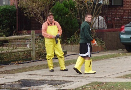 Lynbrook residents Joe Lores and his son, Mikey, worn the proper clothing when they helped clean out an East Rockaway relative's home days after the storm.