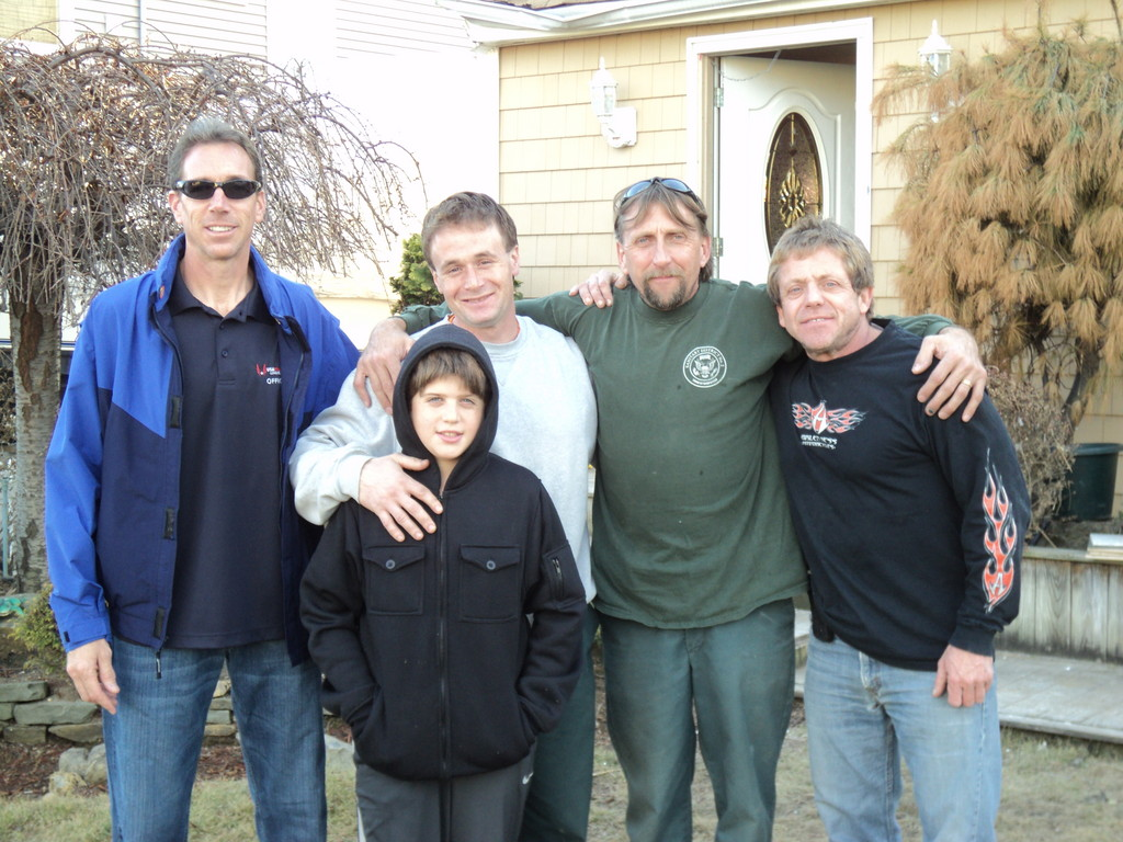 Sani2 workers Jesse Walter, left, Jamie Herbert and John Puglisi Jr. have made fast friends with Dan Wiener, far right, and his 10-year-old son, Troy.