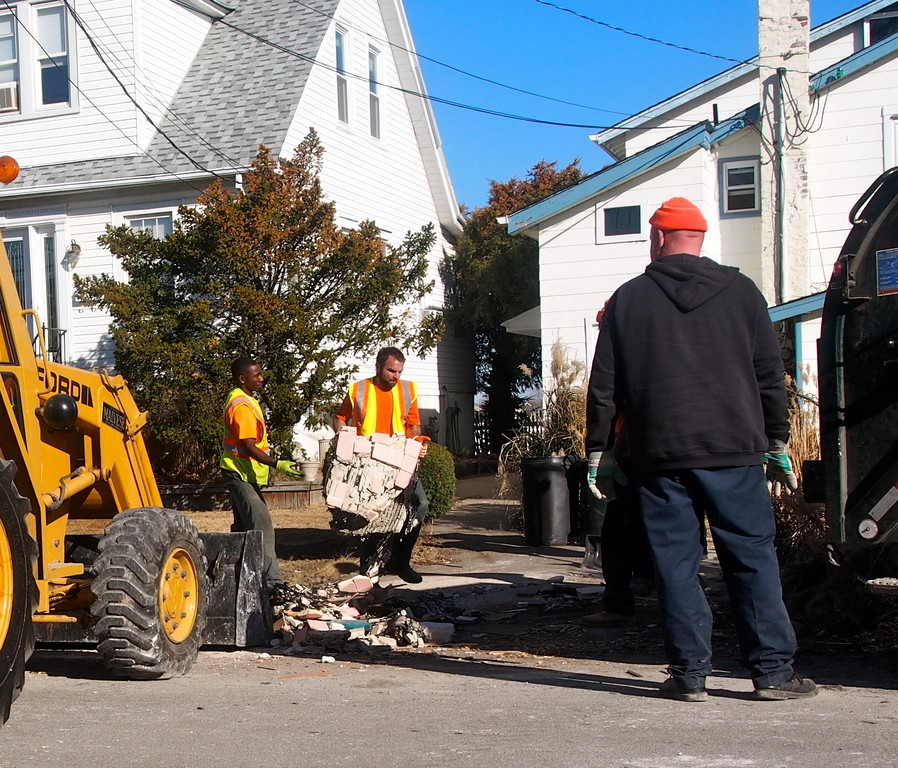 Since Sandy, Sani2 crews have collected more than 7,000 tons of trash — most of it by hand. The district's extra efforts are gaining it support as a referendum on its dissolution approaches on Dec. 12.