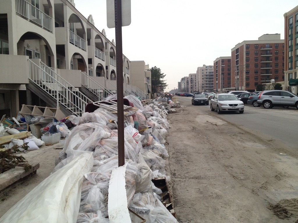 Debris and garbage was piled along West Broadway two weeks after Sandy.