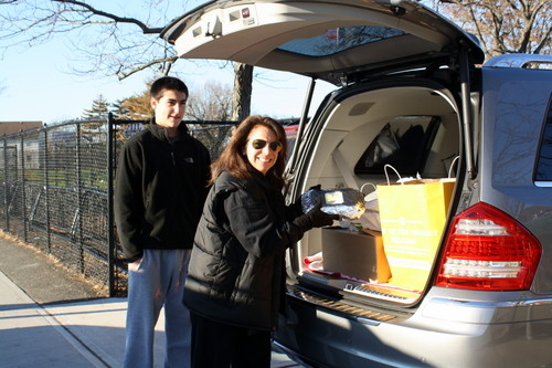 Lynbrook High School student Owen Daly helped PTA parent Melissa Fabel load food into a van for the PTA's annual food drive to benefit the Mary Brennan INN.