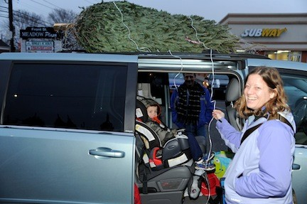 David Klein, 5, and mom Francine were excited to go home with a Christmas tree.