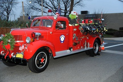 A fire truck is decorated for the occasion