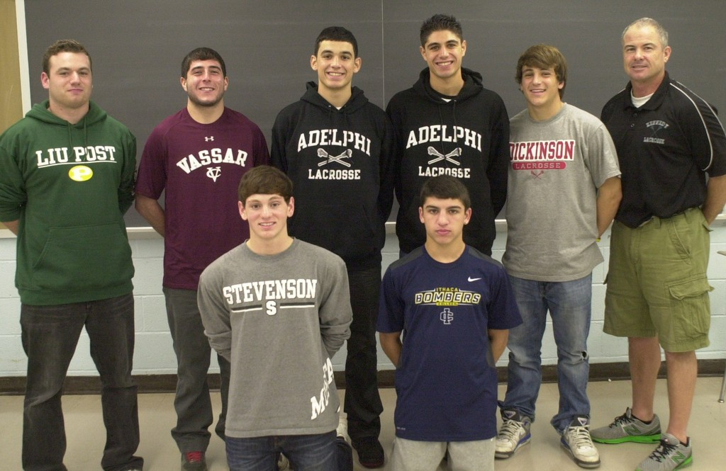 The Kennedy High School lacrosse team boasts seven college recruits this year. They are, top row, from left, Nick DiGangi, Brandon Klein, Ralph Faiella, Chris Racalbuto and Chris Jones; bottom row, Daniel Hartman and Troy Lampert. They were joined by Kennedy's head lacrosse coach, Craig Papach.