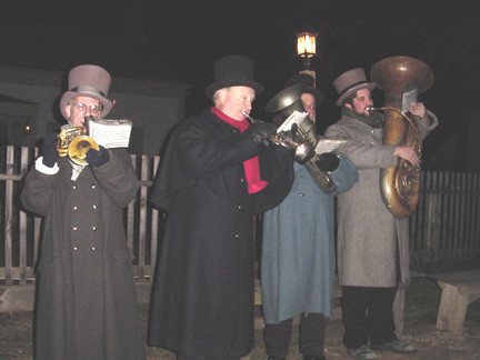 "Step back in time: Old Bethpage Village gives visitors a taste of holiday merriment from days gone by when the restored village welcomes visitors to its ""Candlelight Evenings"" celebration. The Old Bethpage Village Brass Quartet sets a festive tone with Civil War era Christmas songs and other seasonal tunes."