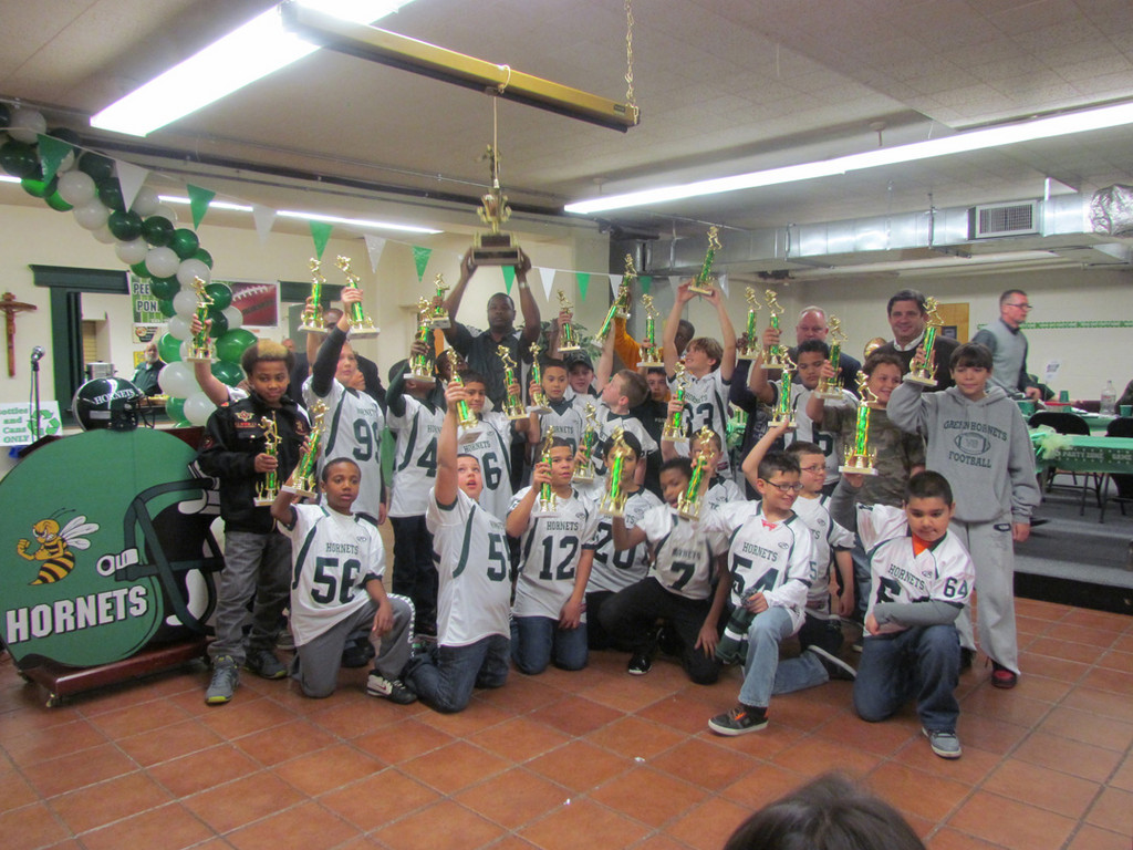 The Midget team of the Green Hornets were NFC Division 1 champs and Superbowl runners-up. Coach John Beaubrun, along with his offensive and defensive coordinators Kent Franks, Osborn Trail, John Garzone and Raul Nunez, were proud of their players and this year�s accomplishments.