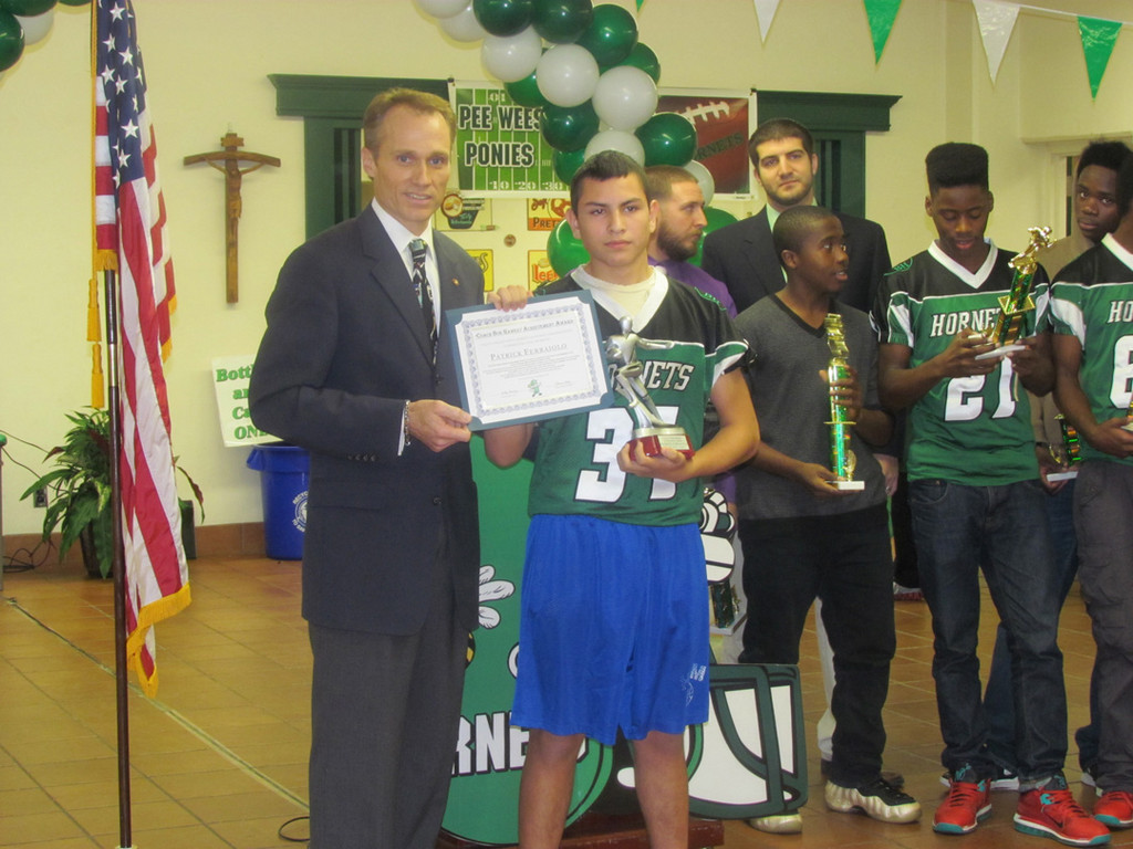 Green Hornets Seniors coach Bobby Hawkey Jr. presented the Bob Hawkey Achievement Award to Patrick Ferraiolo, 14.