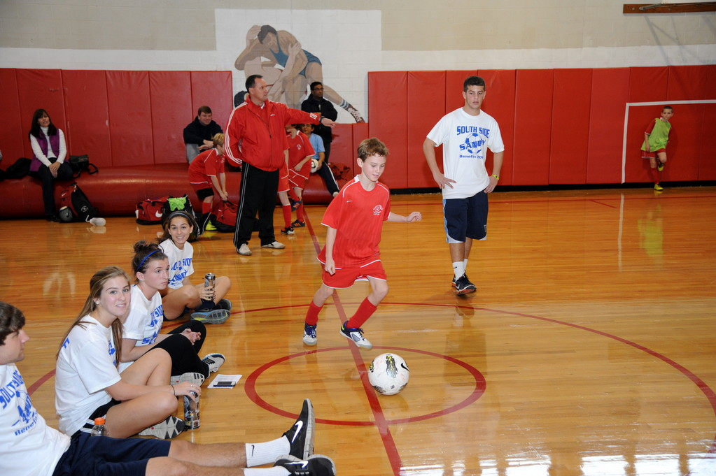 South Side High School Varsity soccer players ran a clinic for young, aspiring players early in the day in the gymnasium.