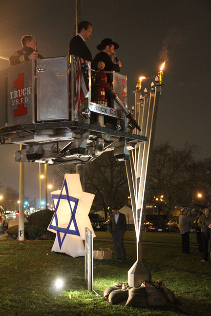 Rabbi Ytzchak Goldshmid and Mayor Ed Fare lit the menorah and spoke to the crowd at Station Plaza on Dec. 8.