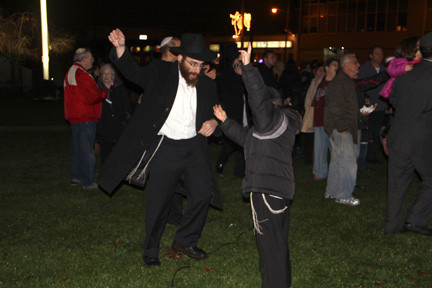 Yakov Jaffe and Mendel Goldshmid enjoyed a dance after the menorah lighting.