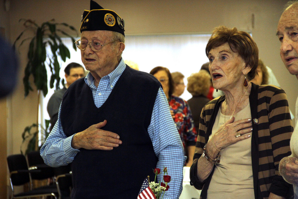 French Legion Award recipient Phillip Kagan and his wife Adele join in singing the National Anthem.
