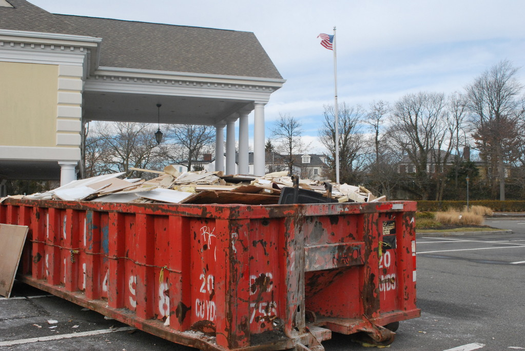 Lawrence Yacht & Country Club debris sat in a dumpster outside the park house building that was severely damaged in Hurricane Sandy.