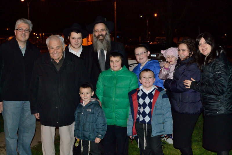 Ville of Cedarhurst Mayor Andrew Parise, second from left, and Rabbi Schneur Wolowik, forth from left, led the lighting of the menorah ceremony in Cedarhurst Park.