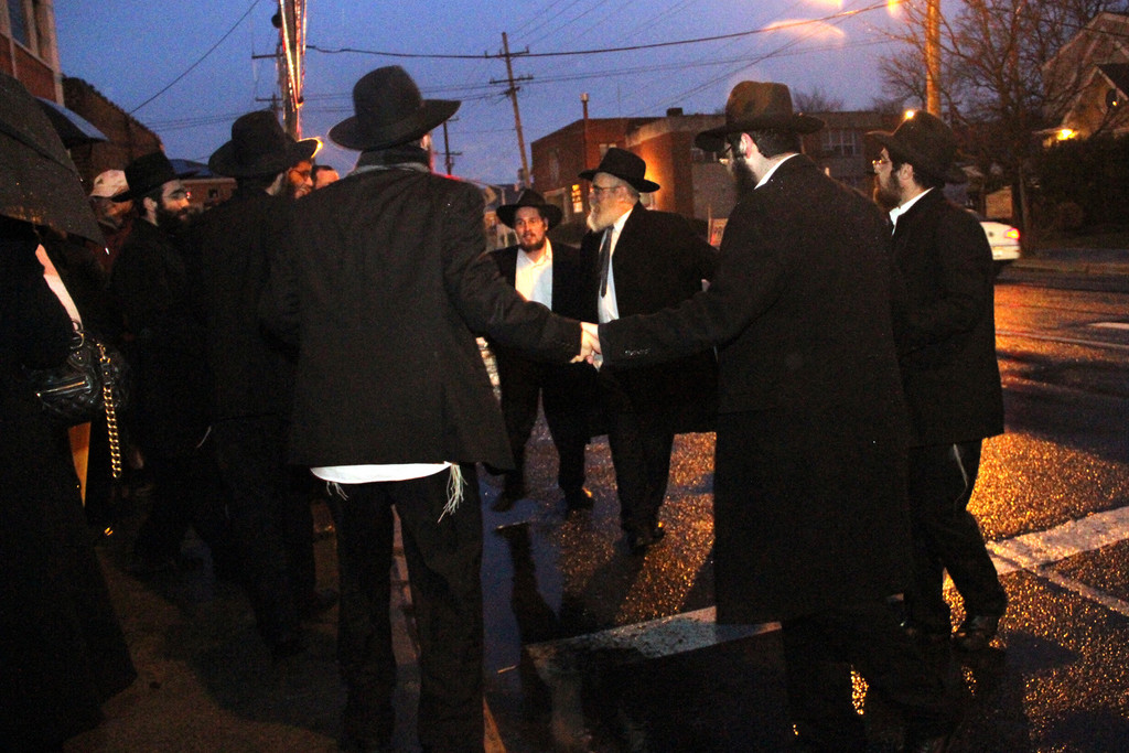 Rabbi Chaim Blachman and congregants danced in the street after the Menorah is lit.