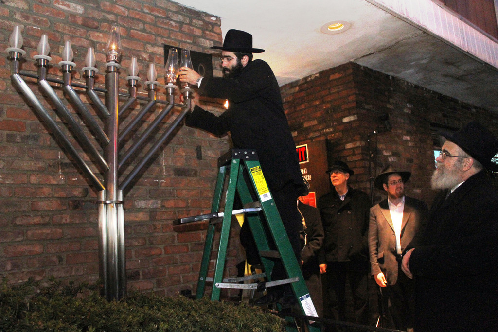 Cantor Simcha Steinberg lit the Menorah.