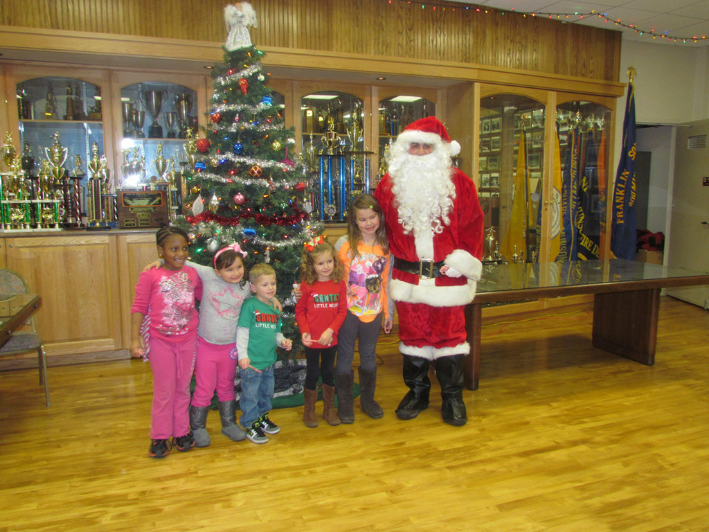 Santa made a quick visit to the Franklin Square Munson/Fire Department prior to their tree lighting ceremony.