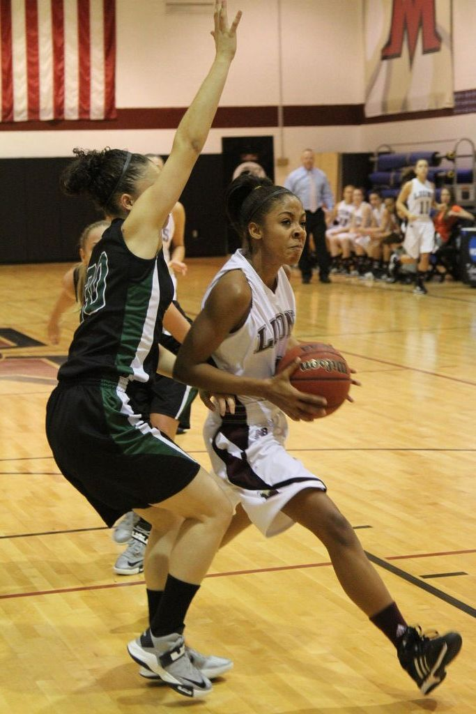 Freshman Alex Hampton drove the lane against Post.