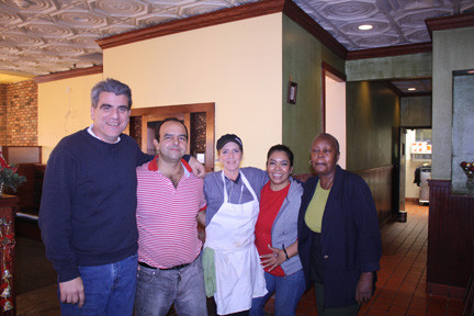 John Manzo, left, with the staff of his restaurant: Eduardo, Christine, Mirta and Pat. Manzo said that they are the reason he was able to reopen after the storm.