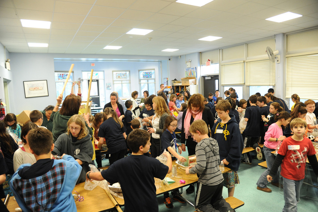 Students from Oceanside and POB assemble food baskets at School 4.