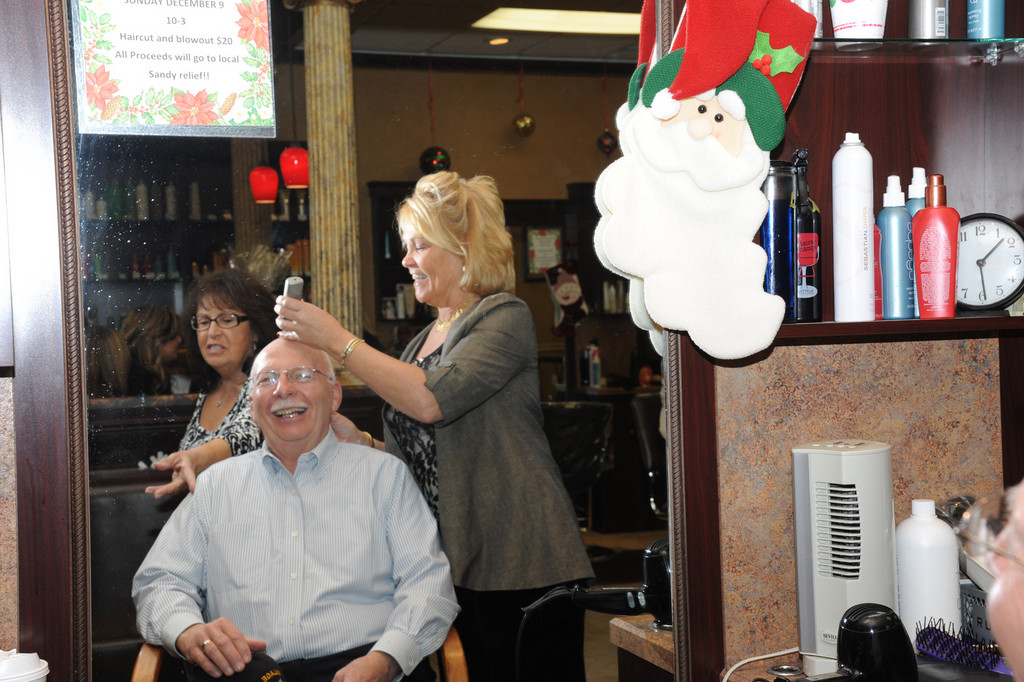 Island Park Mayor James Ruzicka gets a bit of a touch up during the cut-a-thon at Montaage.
