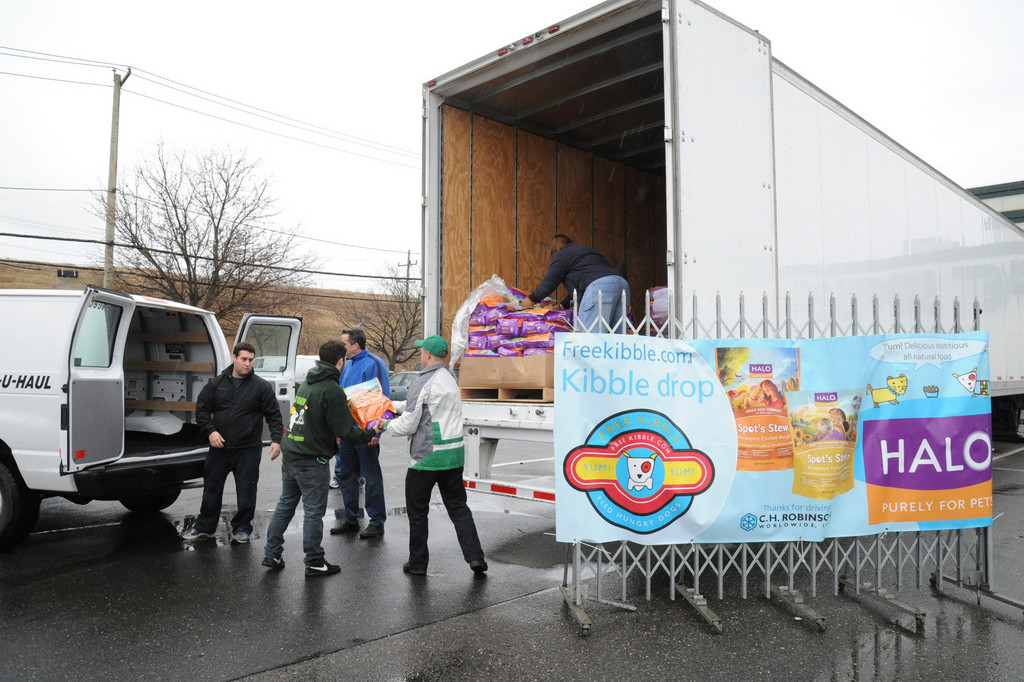 Workers off loaded thousands of meals for pets that were made homeless by Hurricane Sandy.