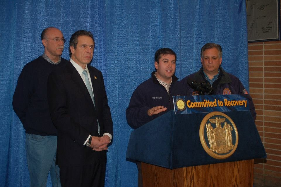 Gov. Andrew Cuomo, left, City Manager Jack Schnirman and County Executive Ed Mangano announced more than $40 million in federal aid to help the city and county pay for costs associated with its debris removal efforts.