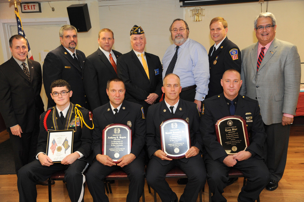 Dillon Burke, Anthony Rugulo, Ronald Kraemer, Jr. and Evan Siar, from left to right in the front row, were all recognized at the American Legion Post 303 on Oct. 26