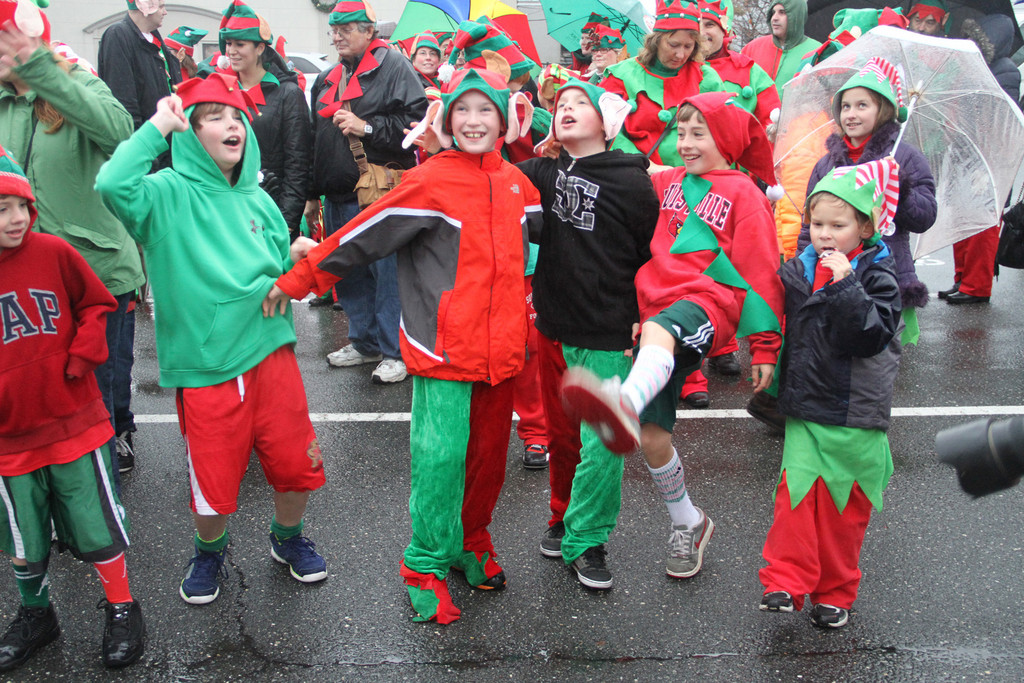 Young elves dance in the parking lot.
