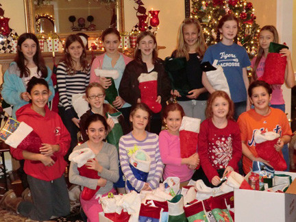 The Girl Scouts of Rockville Centre Troop 843 put together stockings for Long Beach Elementary School students. Pictured from left to right are: (top row) Hannah Behar, Tori Genco, Ali McWalters, Devin McCArthy, Megan Sullivan, Shannon Bender, Brooke Brown. (Middle Row) Marisa Marzolini, Meghan Cappitelli.  Bottom Row: Melissa Aliotta, Alexa Sitterly, Elizabeth Vaupel, Casey Bender, Isabella Zangari.  Not Pictured in Troop 843 are: Olivia Rodriguez, Lauren Thomas, Nicole Graziano, Sarah Quilty, Camryn Curnuck, Caroline Ditchik.