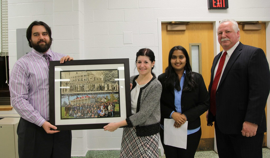 Art Teacher Mario Bakolov presented the picture to Board of Education Vice President Elise Antonelli on Dec. 11. They were joined by Central senior Rida Javaid and Principal Dr. Joseph Pompilio.