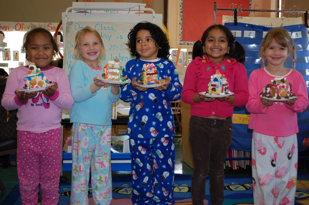Robert W. Carbonaro School kindergarten students, from left, Akiya Gonzalez, Winter Libsman, Ariel Cabra, Sadie Seulal and Danielle Zervos showed off their completed gingerbread houses.