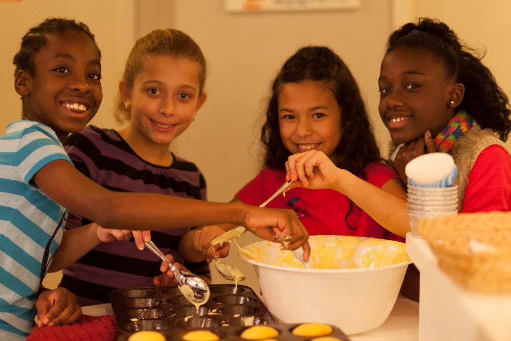 Clear Stream Avenue School students, from Left, Adia Michell, Faith Acevdeo, Alana Moy and Victoria Alcala make cookies and cupcakes for the families at the Ronald McDonald House of Long Island on Dec. 16.